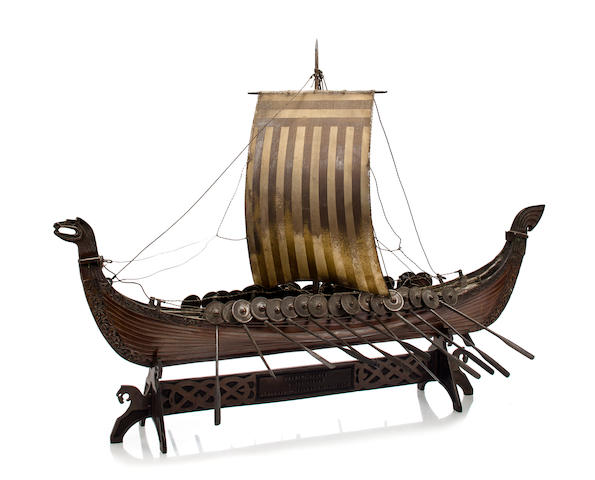 A bronze model of the Osberg Viking ship<BR /> circa 1926 30 x 8 x 21 in. (76.2 x 20.3 x 53.3 cm.) model on stand. 2