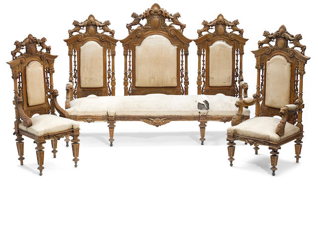 An American Renaissance Revival suite of carved walnut and cherry seat furniture <BR />late 19th century