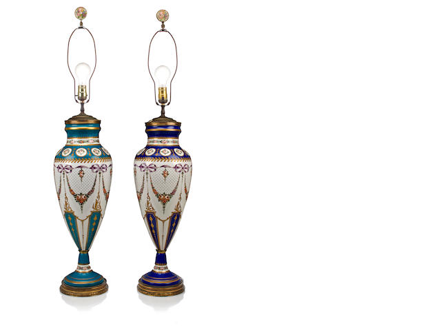 A pair of 'Sevres' porcelain vases mounted as lamps<BR />20th century