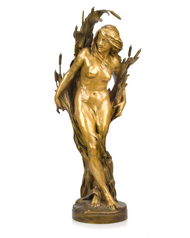 A patinated bronze figure of a woman in reeds<BR />after a model by Raoul Larche with Decaux foundry stamp