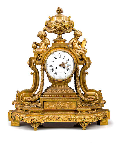 A Louis XVI style gilt bronze figural mantel clock<BR />fourth quarter 19th century