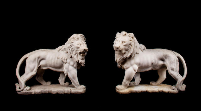 A pair of Italian carved white marble figures of standing lions<BR />first half 20th century