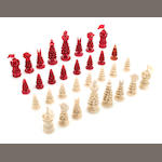 A Chinese red-stained and natural ivory chess set, 19th century