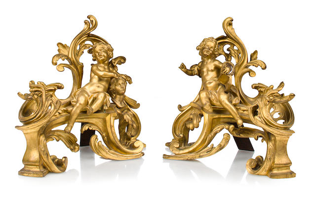 A pair of Louis XV style gilt-bronze figural chenets, one signed Vian
