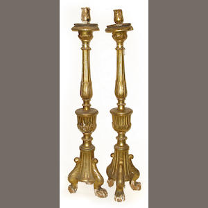 A pair of Neoclassical carved giltwood floor standing pricket candlesticks late 18th century