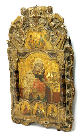 A Greek polychrome and gilt decorated relief carved icon