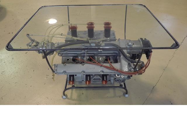 A Ferrari Dino engine cocktail table awarded to Ludovico Scarfiotti in 1965,