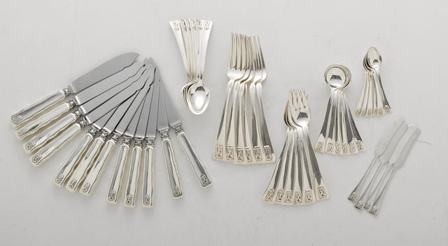 A sterling partial flatware set by maker unknown <BR />Pattern similar to Tiffany's Lap Over Edge with custom applied monogram: DJZ  (46)