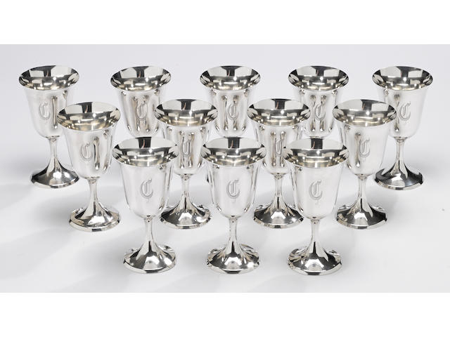 A sterling set of twelve water goblets by The Steiff Co., Baltimore, MD, dated 1941  # 0801, monogrammed: C