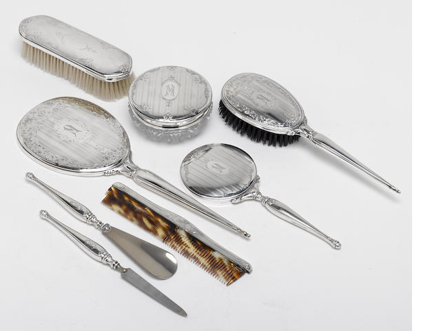 An assembled group of Canadian sterling mounted lady's dressing table itms by Birks, Montreal <BR />monogrammed: M  (8)