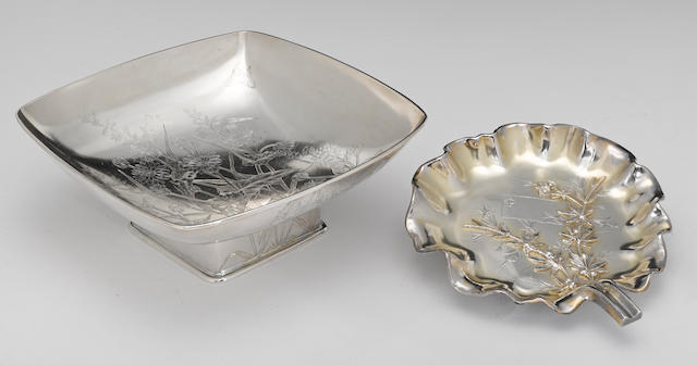 A sterling bowl with engraved decoration and a parcel-gilt footed tray with applied decoration, both in the Japanese taste Gorham Mfg. Co., Providence, RI, dated 1880<BR />Wood & Hughes, New York, NY <BR /># 1600, engraved on underside: J. M. Easton, Sept. 7th, 1880<BR /># 110, monogrammed: CE  (2)