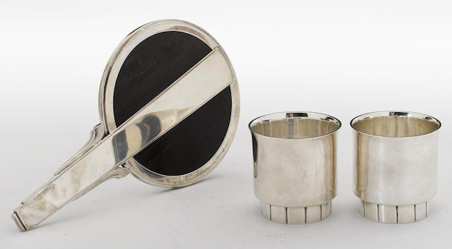 A Danish art deco sterling and rosewood mounted lady's dressing table hand mirror with an American sterling hand wrought pair of beakers <BR />Georg Jensen, Copenhagen, designed by Harald Nielsen<BR />William van Erp for Dirk Van Erp, San Francisco, CA <BR />#224