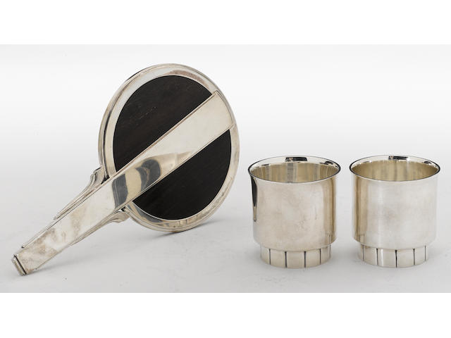 A Danish art deco sterling and rosewood mounted lady's dressing table hand mirror with an American sterling hand wrought pair of beakers  Georg Jensen, Copenhagen, designed by Harald Nielsen William van Erp for Dirk Van Erp, San Francisco, CA  #224