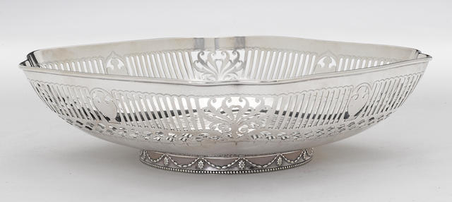 A sterling shaped square footed fruit bowl with reticulated sides and engraved decoration by Gorham Mfg. Co., Providence, RI, dated 1888 <BR /># 2570