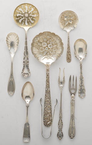 A silver flatware group  (9)
