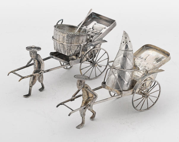 A Chinese export silver group of two similar novelty figural condiment frames fitted with cellar with spoon and caster by maker's untraced