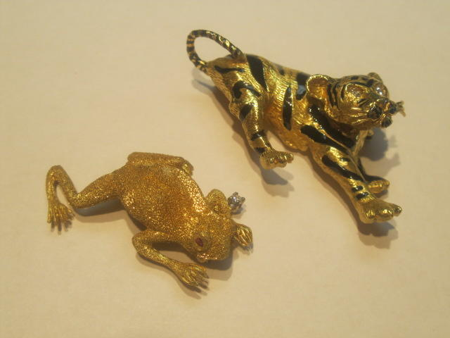 A collection of two 18k gold, enamel, ruby and diamond animal brooches
