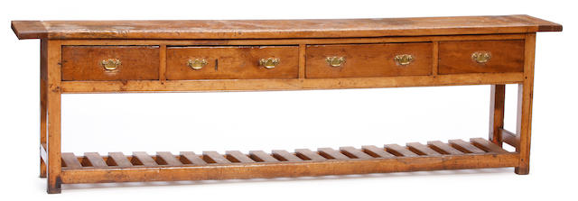An English Provincial fruitwood dresser base