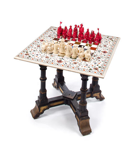 A Chinese Export carved ivory chess set with an Indian inlaid marble chess board