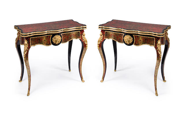 A pair of Napoleon III gilt bronze mounted tortoisehell and brass inlaid ebonized Boulle marquetry games tables<BR />second half 19th century
