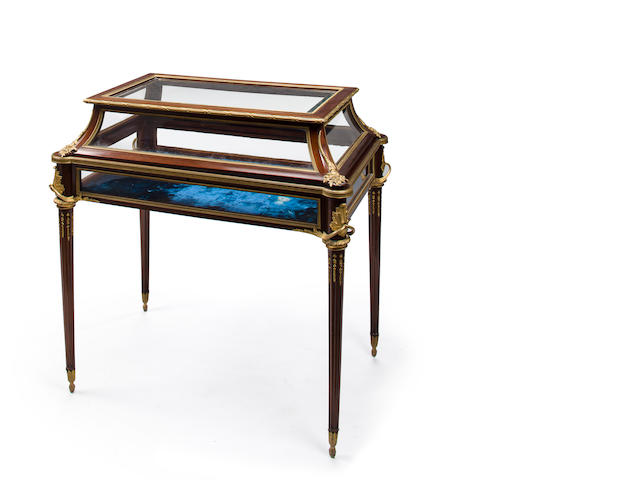 A Louis XVI style gilt-bronze-mounted mahogany vitrine table<BR />attributed to Maison Mottheau & Fils<BR />circa 1900