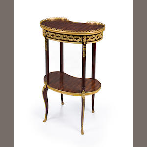 A Louis XVI style gilt bronze mounted mahogany parquetry table en rognon. circa 1900