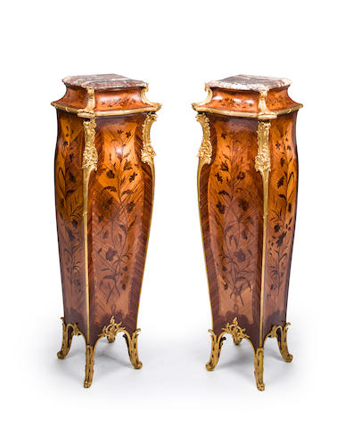 A pair of Louis XV style gilt bronze mounted kingwood marquetry pedestals<BR />Joseph Emmanuel Zwiener<BR />fourth quarter 19th century