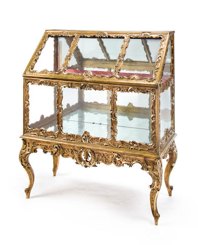 A Rococo style giltwood vitrine cabinet on stand<BR />first half 20th century