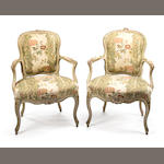 A pair of Louis XV carved and painted fauteuils en cabriolet<BR />mid-18th century