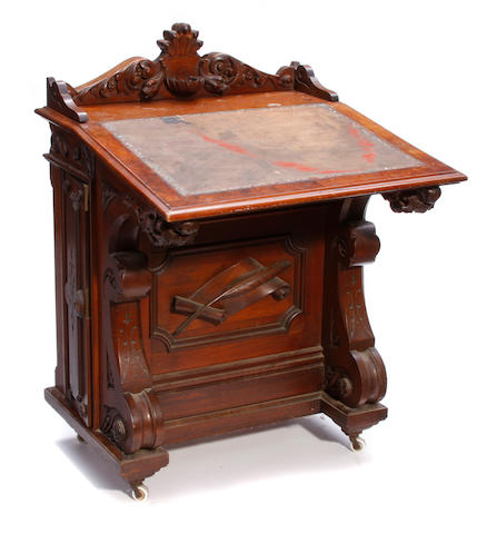 An American Aesthetic carved walnut drafting table