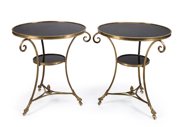A pair of Neoclassical style gilt bronze and black marble circular guéridons<BR />mid-20th century