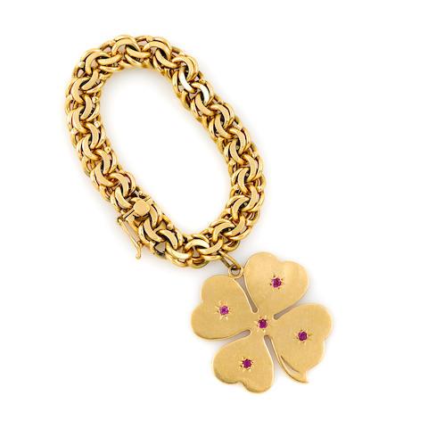 A 14k gold cloverleaf charm bracelet, with an extra link