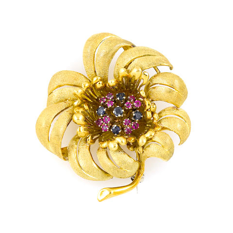 A gem-set and 18k gold flower brooch
