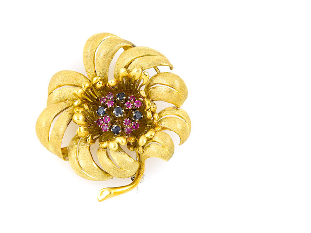 A gem-set and gold flower brooch