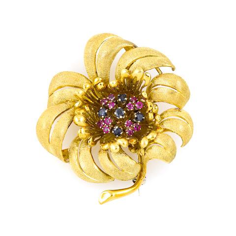 A gem-set and gold flower brooch