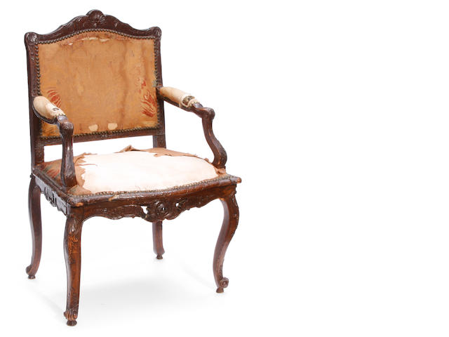 A Louis XV carved walnut fauteuil