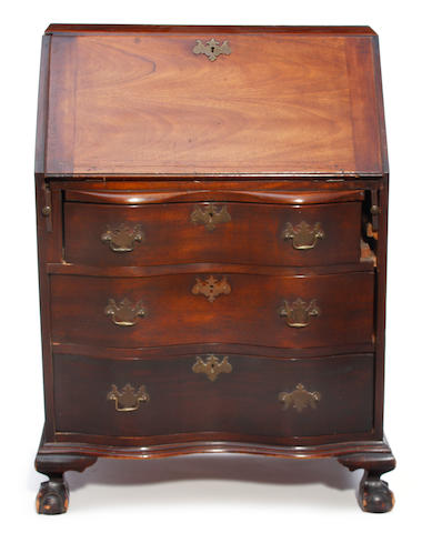 A Chippendale style walnut slant front desk