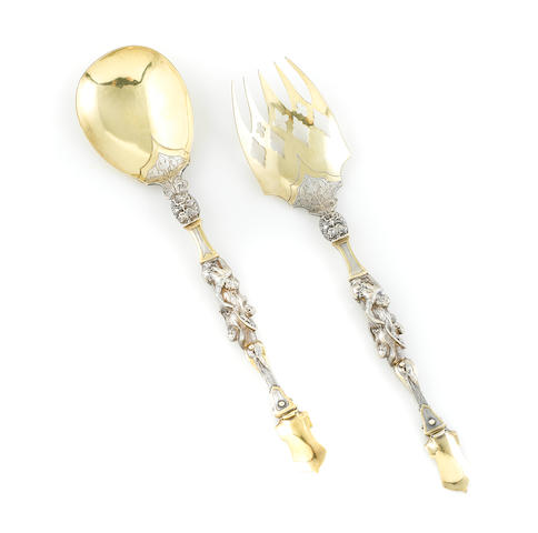 A pair of Victorian parcel gilt sterling silver heraldic servers