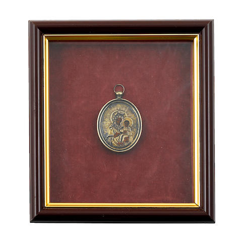 A Russian icon medallion, with silver oklad, in shadow box frame