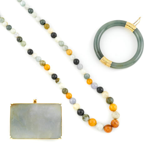 A collection of multi colored jade; comprising a bead necklace, a pendant and a bangle