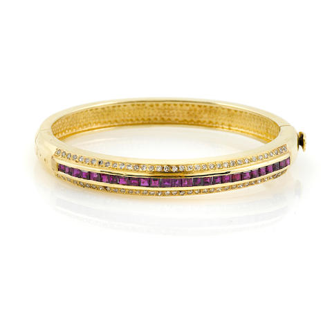 A diamond, ruby and 14k gold bangle bracelet