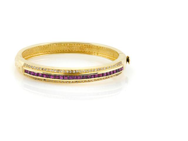 A diamond, ruby and 14k gold bangle bracelet
