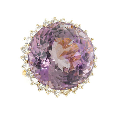 An amethyst, diamond and gold ring