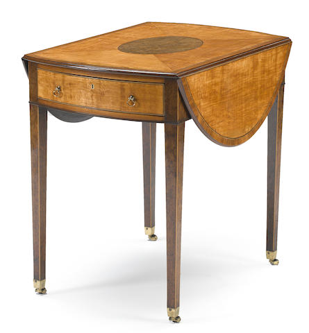 A George III satinwood and yewwood Pembroke table <BR /> late 18th century