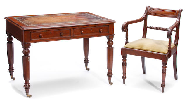 A William IV leather inset mahogany writing table