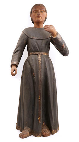 A Spanish Colonial paint decorated figure of a monk