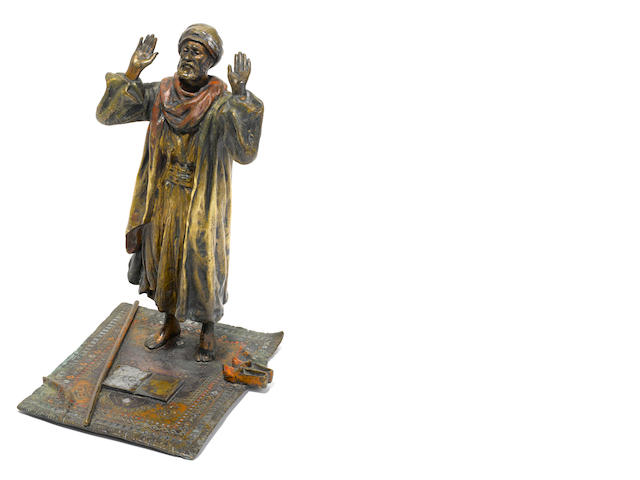 An Austrian cold-painted bronze figure of a robed man praying