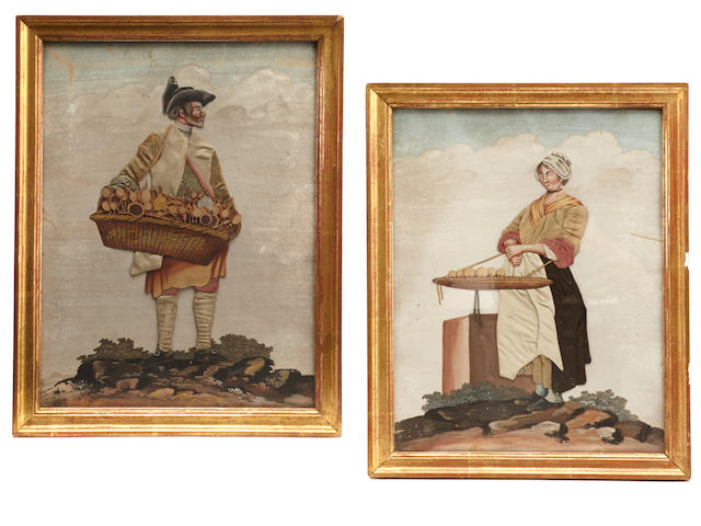 Two French paper and cloth figures of a man and woman selling wares