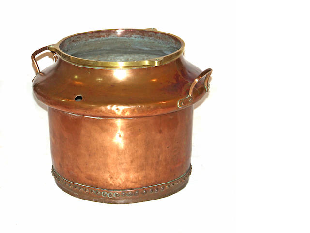 A large copper and brass two handled cauldron late 19th century
