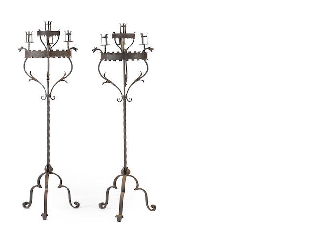 A pair of Italian Renaissance style iron and tole torcheres <BR /> 19th century